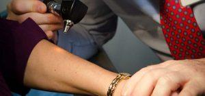 dermatologist looking for skin disease