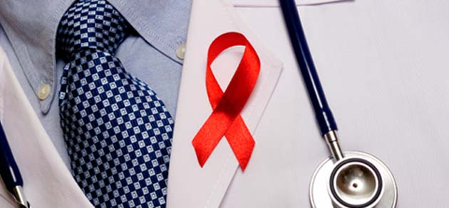 doctor wearing red ribbon for HIV/AIDS