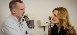 doctor consulting with an urgent care patient