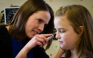 Family Nurse Pracitioner, Christina Kay with pediatric patient in Warrensburg NY
