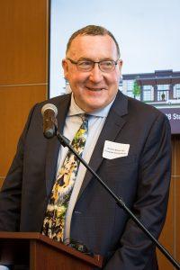 Maurice Racine, MD giving a presentation.